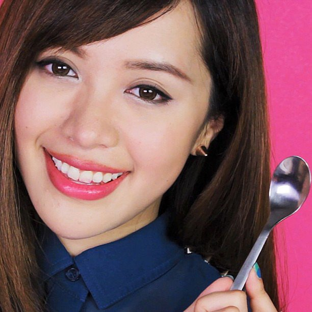 Michelle Phan showed off a bold lip hue this week. Source: Instagram user michellefawn