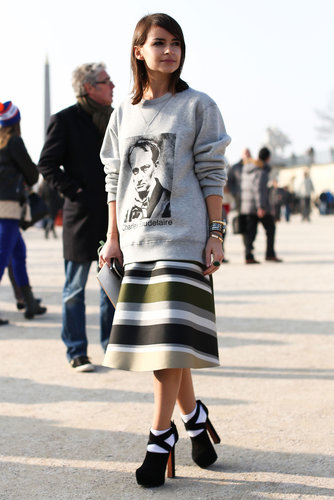 Miroslava Duma perfected sportif-chic in a sweatshirt, flared skirt, and platforms outside the shows.