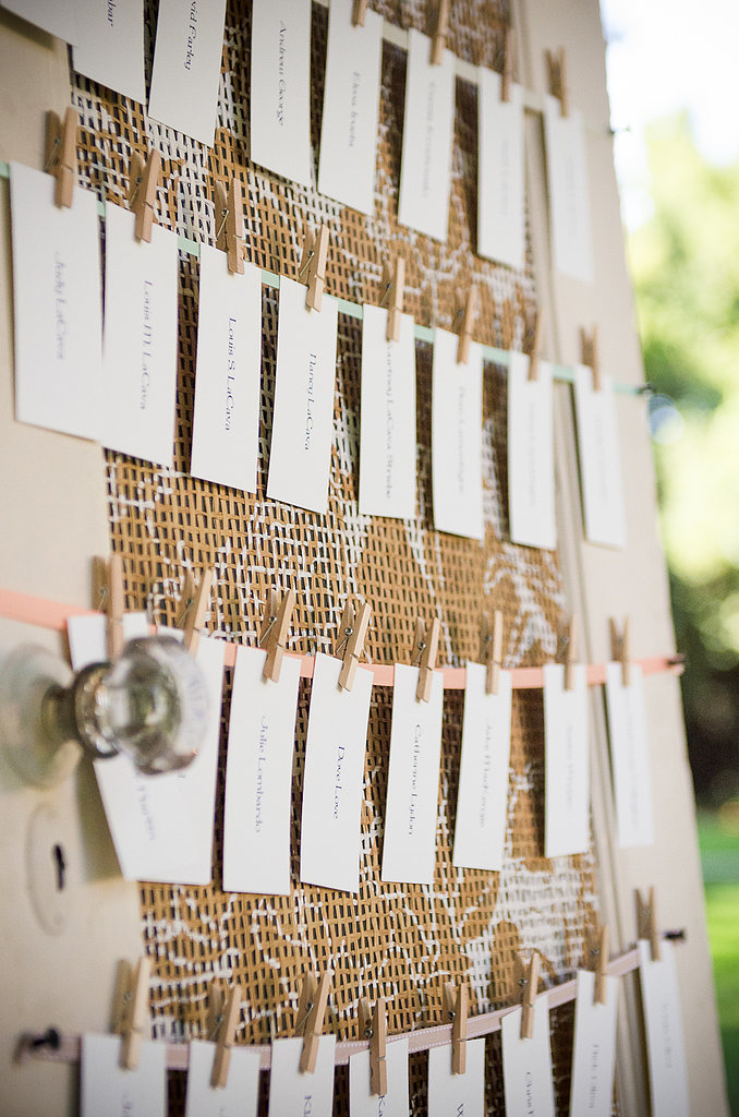 A rustic, hand-painted door displayed the table cards.  Source: Juliette Tinnus