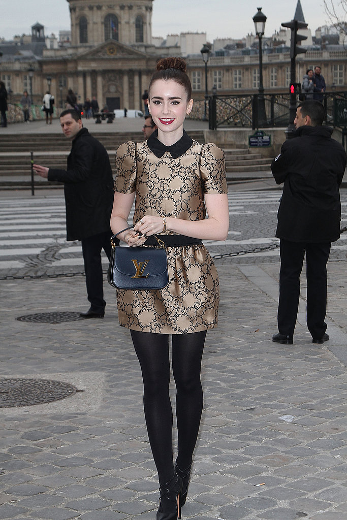Lily Collins stepped out in Paris for Louis Vuitton's show in a gold-and-black collared dress from the label's Pre-Fall '13 collection.
