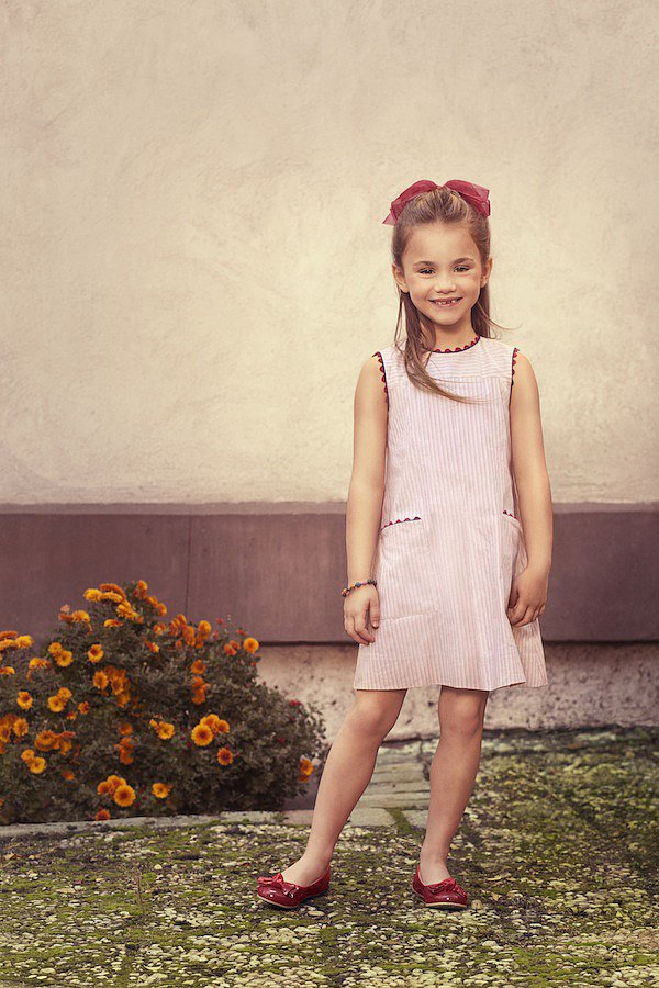 "The Red Vintage Striped Dress ($135) was designed for ""Isabelle"" — a curious Parisian 5 year old with an interest in the arts, just like her maman, who is a docent at the Musee D'Orsay."