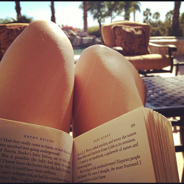 I snapped this pic of myself reading Bare Bones by Kathy Reichs during a weekend getaway in Palm Springs, CA.