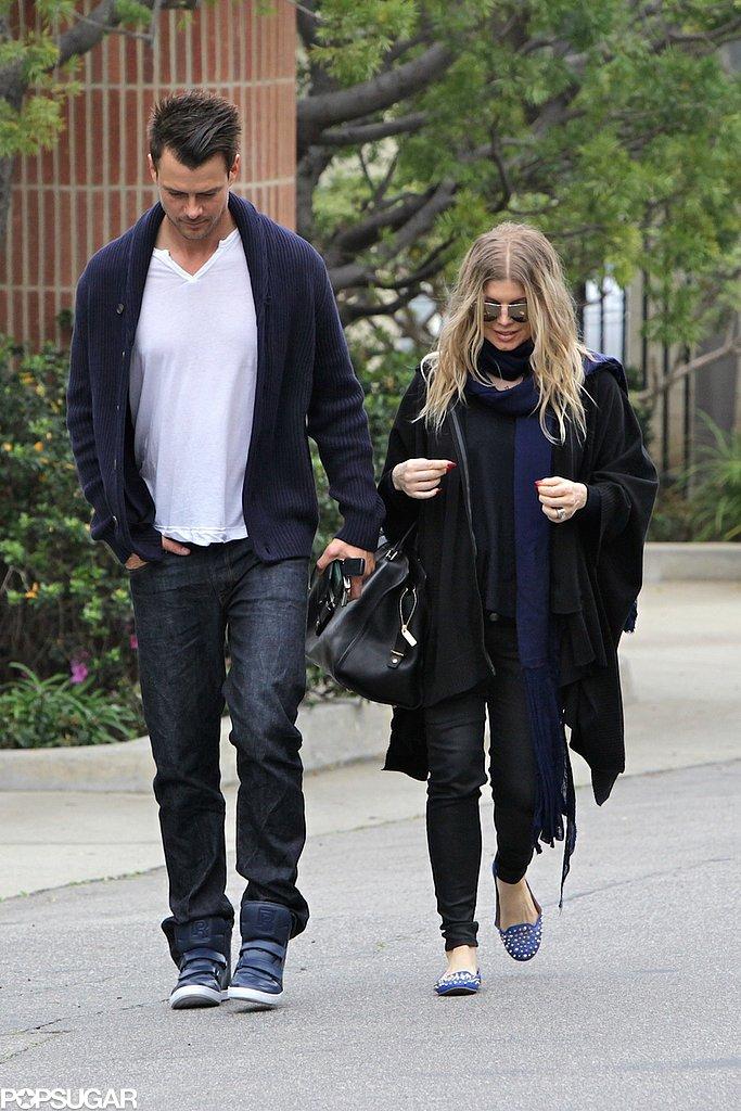 Josh Duhamel and Fergie both wore black and navy.