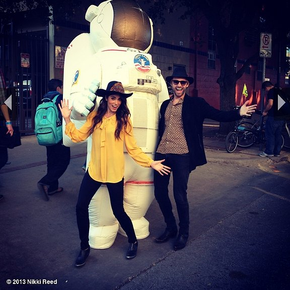 Nikki Reed and her husband, Paul McDonald, posed with a giant astronaut at SXSW. Source: Nikki Reed on WhoSay