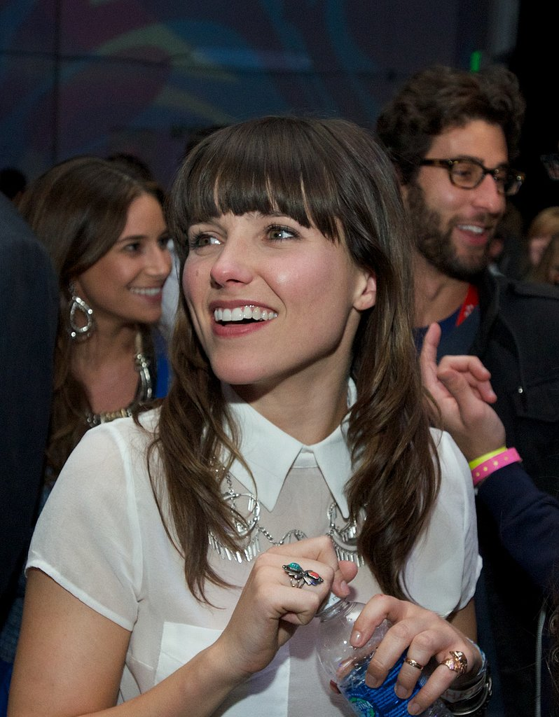 Sophia Bush joined the crowd at the Passion Pit performance, decked out in a sweet white collard blouse and a collection of cool rings.