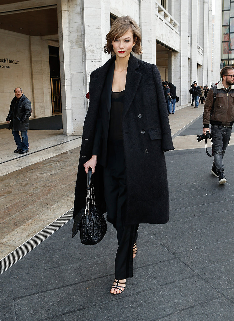 While strutting the streets of NYC, Karlie wore head-to-toe black and accessorised via a Christian Dior bag and strappy sandals.
