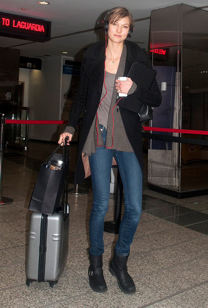 Karlie Kloss's airport style consisted of black moto boots, skinny jeans, and a big black coat.