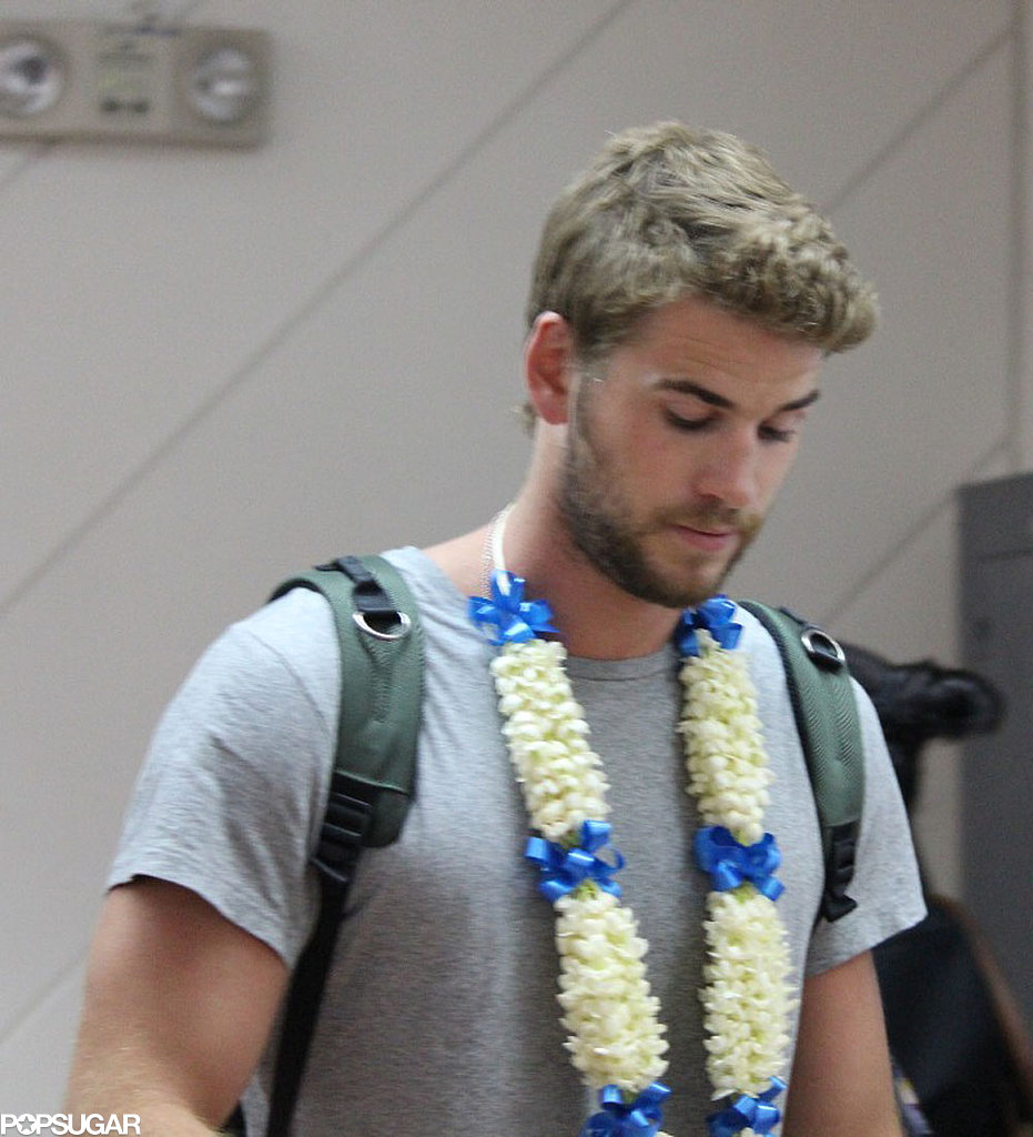 Liam Hemsworth wore a flower necklace.