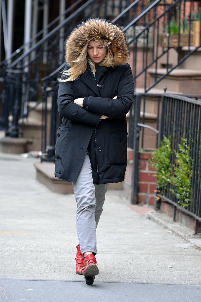 Sienna Miller kept her hood up to stay warm.