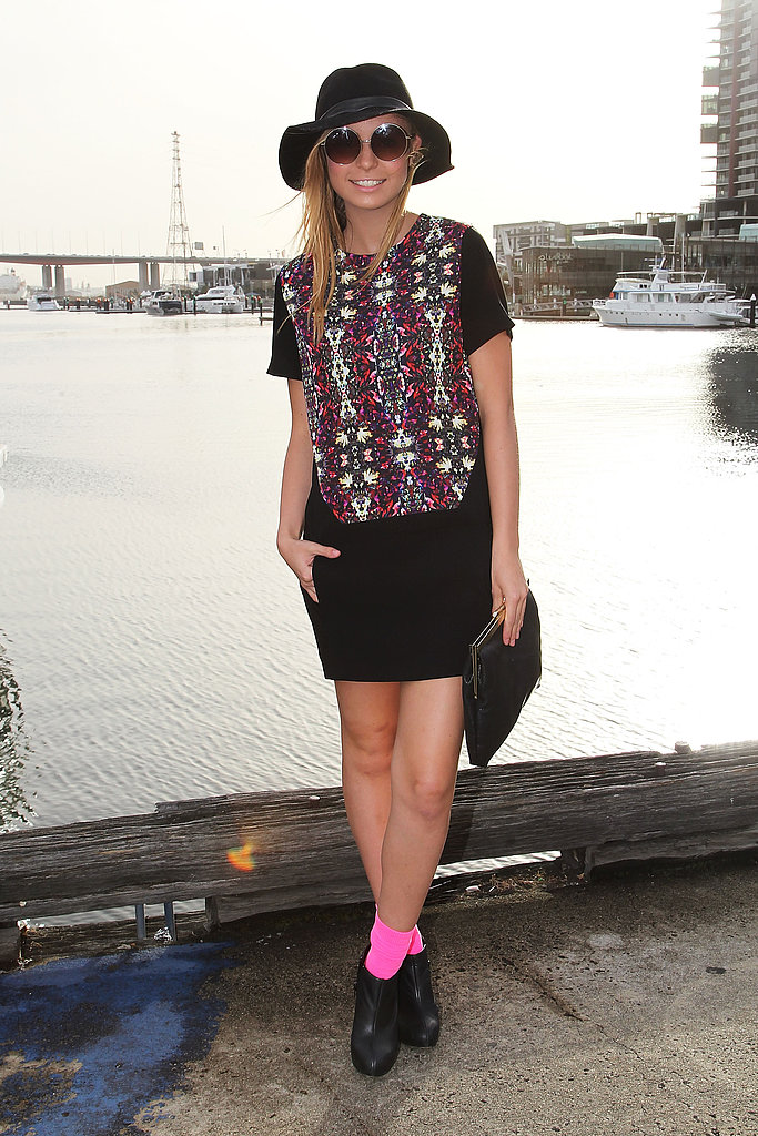 Neon socks added a playful pop of color to this downtown-cool ensemble.