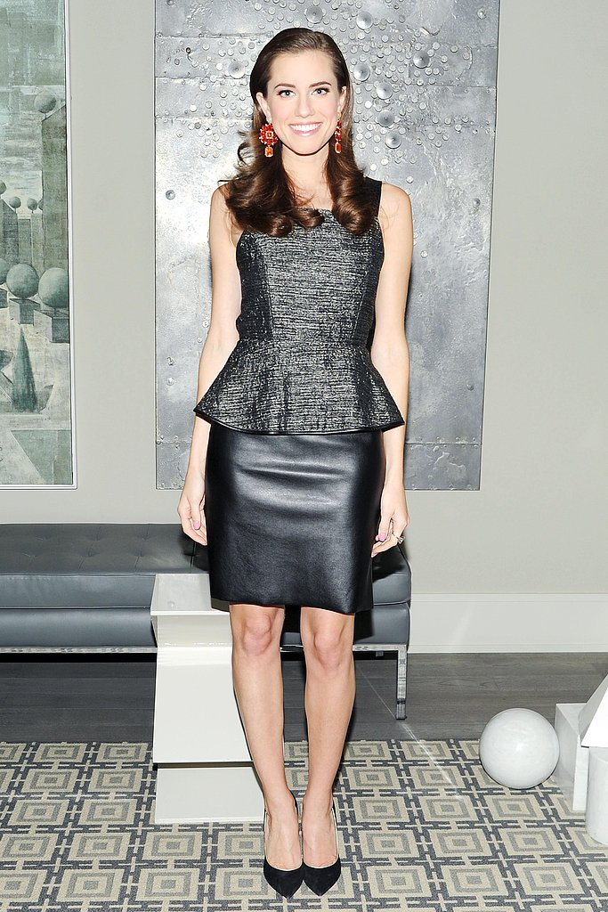 Allison Williams made an on-trend fashion match when she paired a metallic peplum blouse with a black leather skirt at a Barneys New York event in NYC. We also love the pop of color via her orange-and-red statement earrings by Irene Neuwirth.