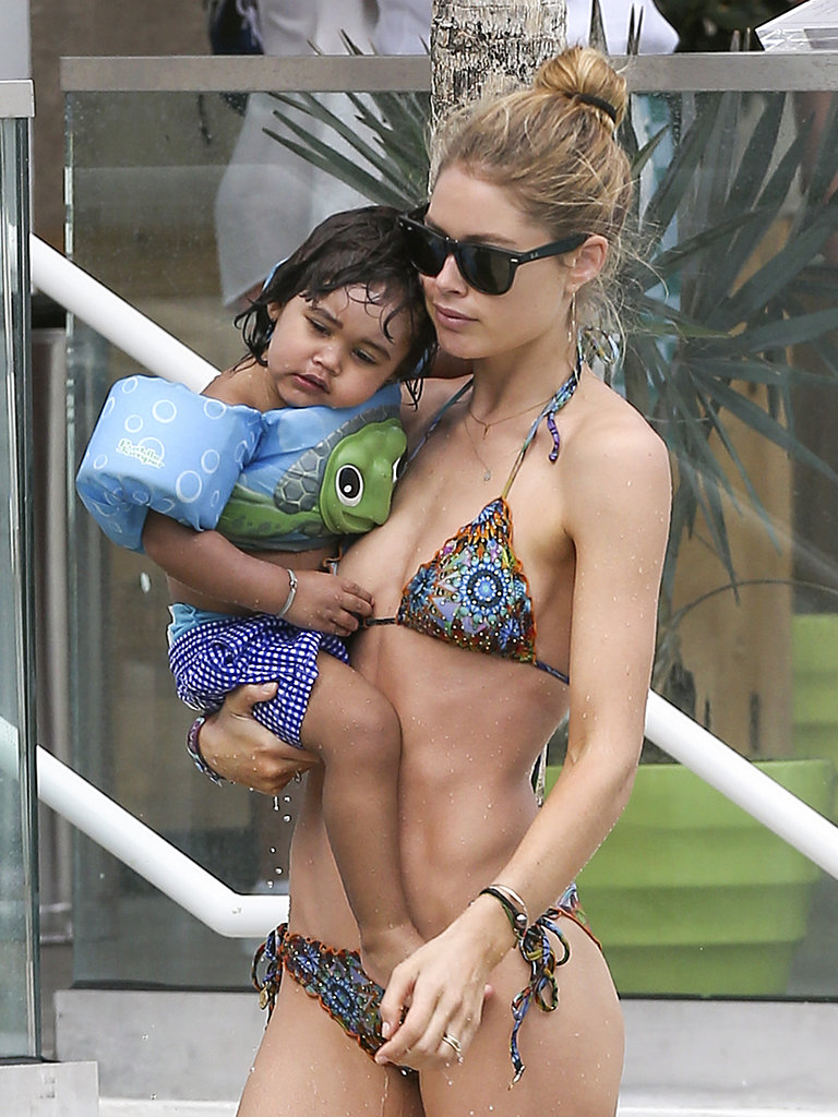Doutzen Kroes carried her little boy, Phyllon James, after a long Sunday by the pool in Miami.