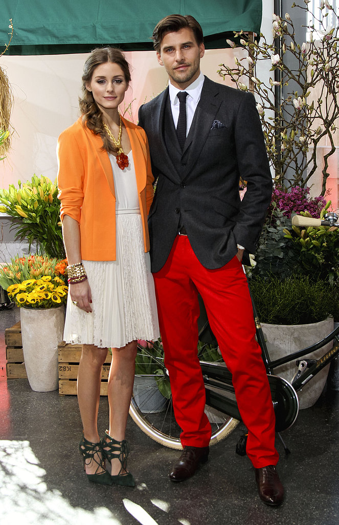 With nods to Spring, Olivia outfitted a sweet, pleated day dress with a bright tangerine-hued jacket and coral jewels, then finished the look with a pair of lace-up heels for a presentation in Hamburg, alongside beau Johannes Huebl.