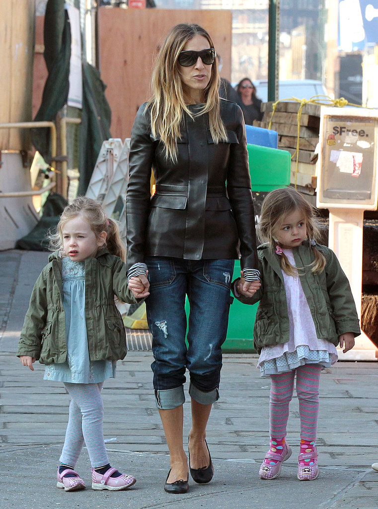 Sarah Jessica Parker held both her twins' hands who were wearing adorable matching Paul Frank shoes.