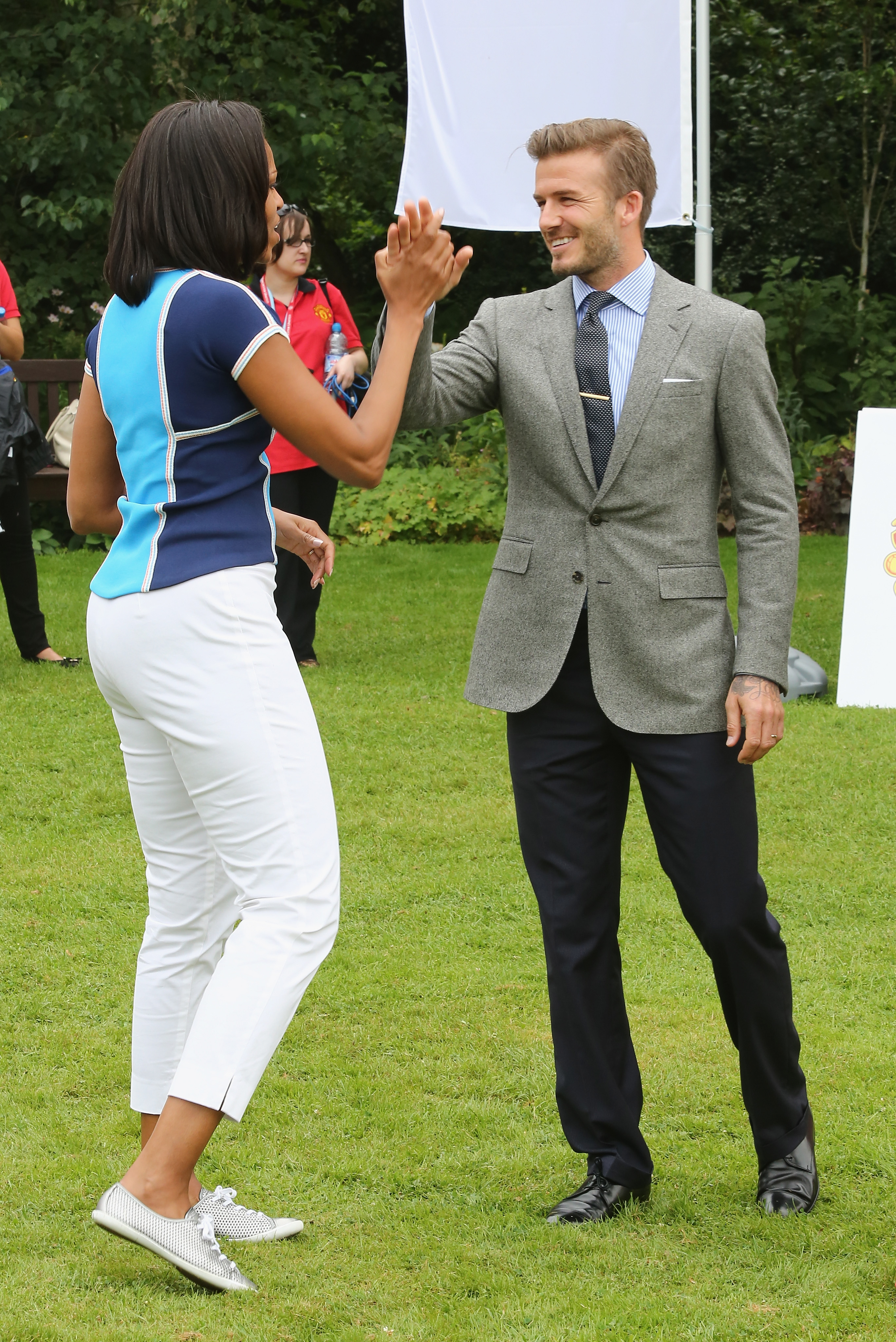 David Beckham and Michelle Obama shared a mid-air slap in July 2012 during an event in London.