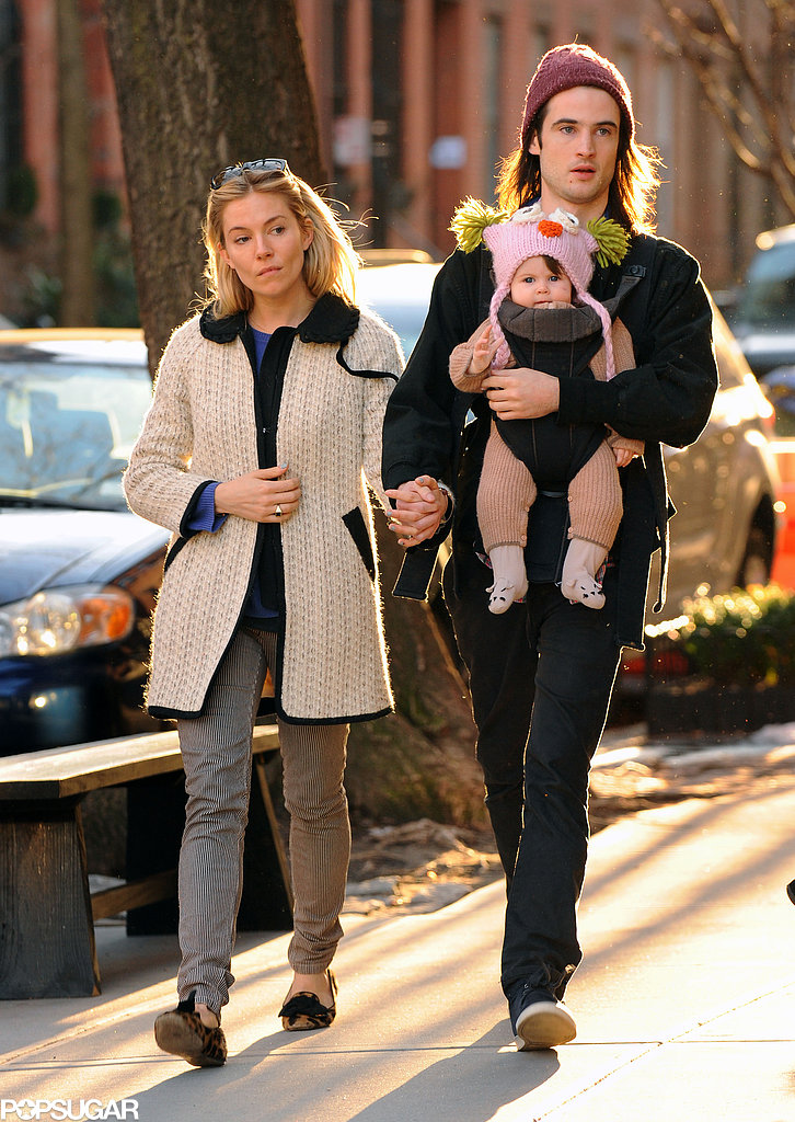 While taking a stroll with Tom Sturridge and their baby girl, Marlowe, Sienna mixed prints in her leopard loafers and striped jeans. She then bundled up in a knit coat and a bright blue sweater.