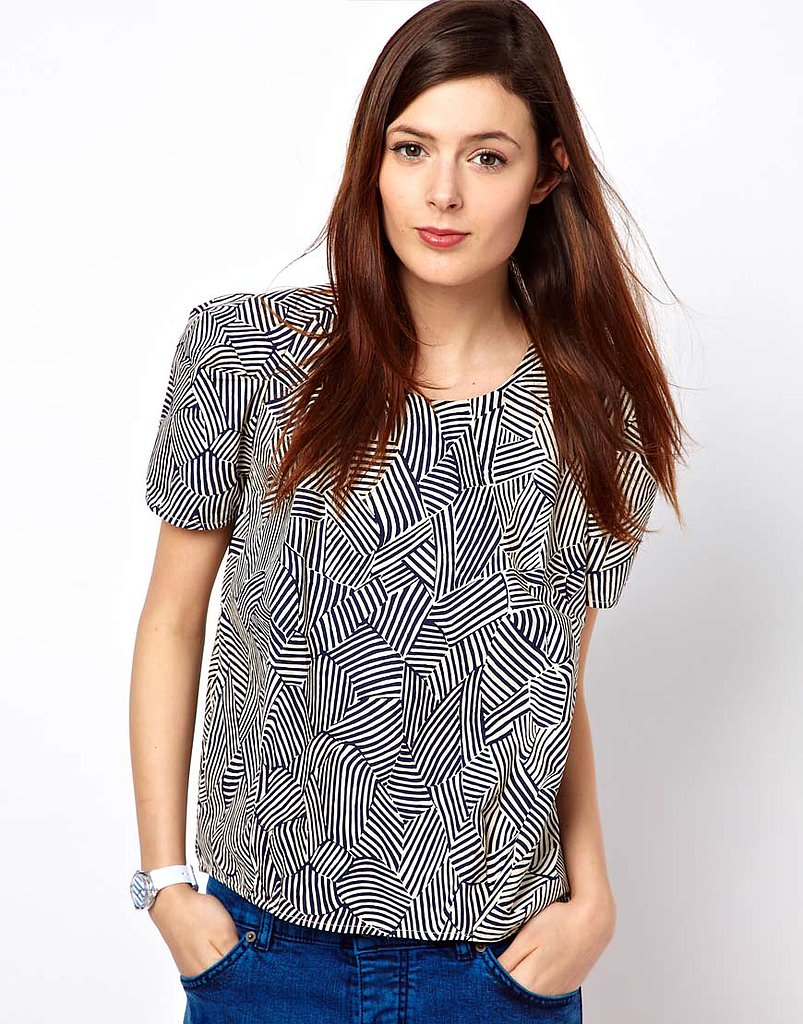 Try taking this bold-printed BZR wave-print shell top ($148) to work with cropped trousers and low heels for a thoroughly modern play on office attire.