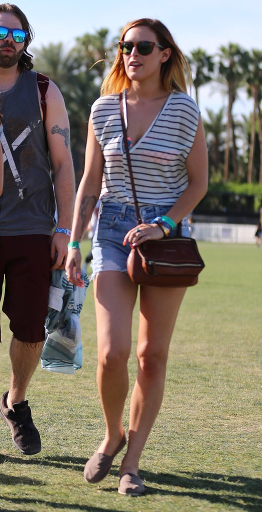 Rumer Willis sported a classic striped tee, then added festival cool via denim cutoffs, a pair of Toms shoes, and a crossbody bag.