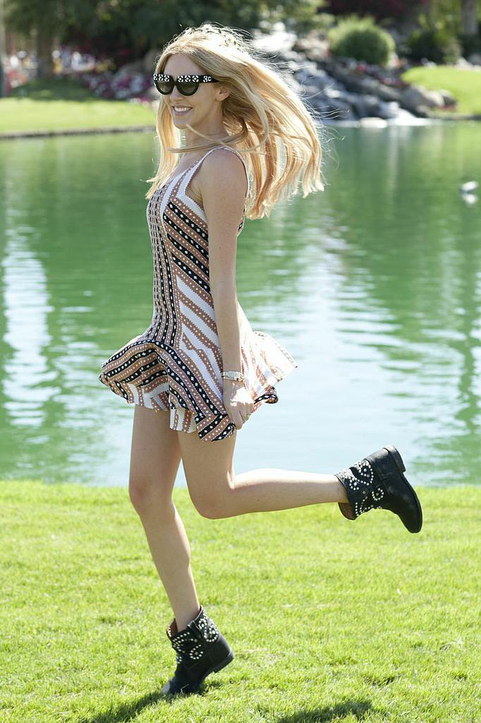 A partygoer danced the day away in a printed fit-and-flare dress and studded Isabel Marant boots.
