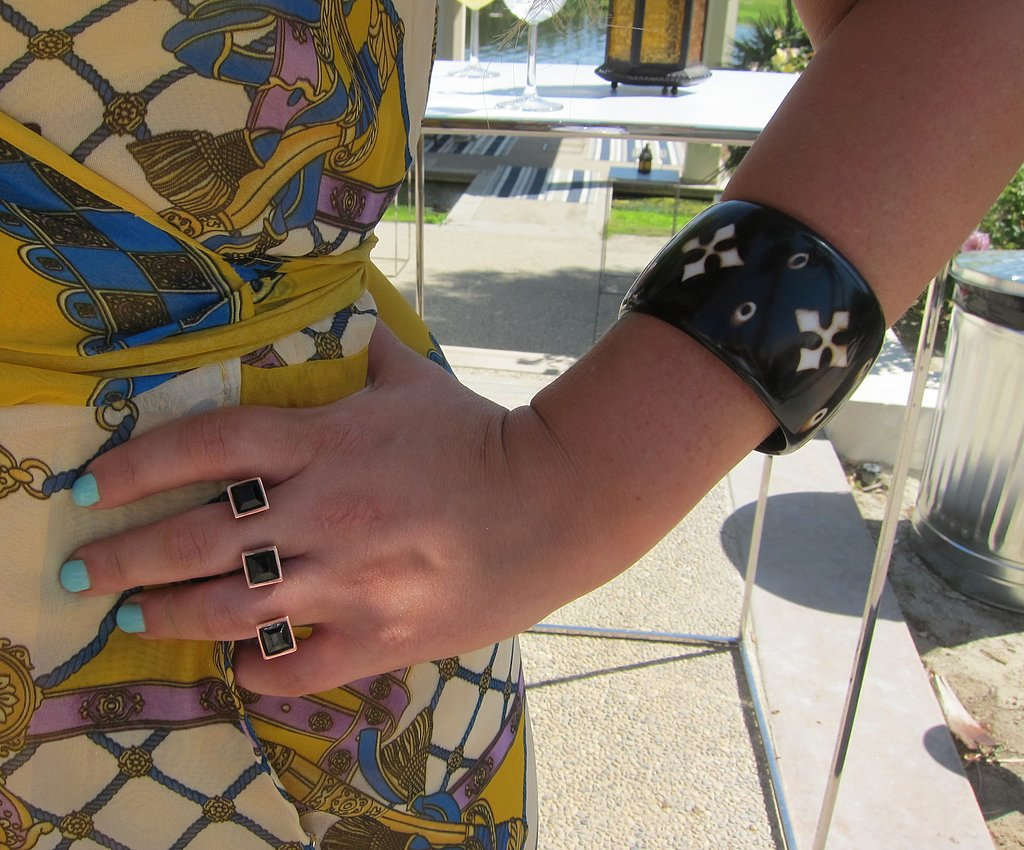 This three-finger knuckle ring and a resin bracelet were punky and pretty.