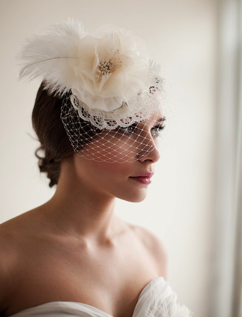 This Melinda Rose Design bridal mini hat veil ($175) emotes a sweet, throwback vibe for the art-deco bride.
