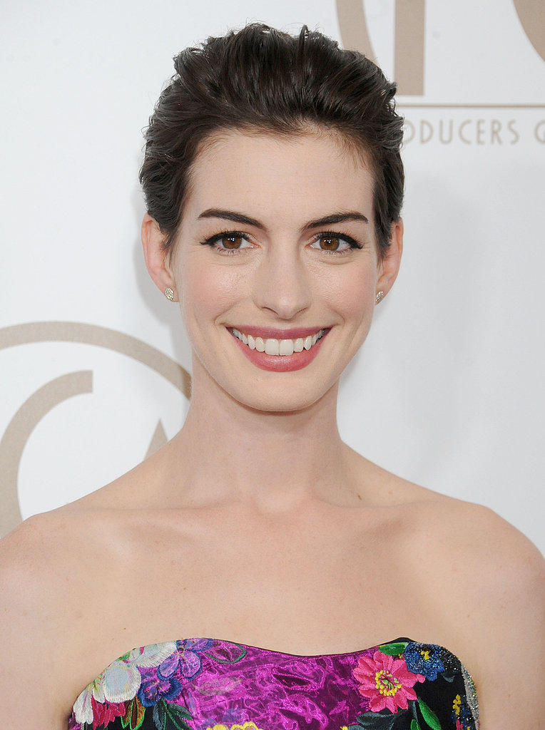 Have a grown-out pixie? Create the illusion of an updo by having your hair brushed back like Anne Hathaway.