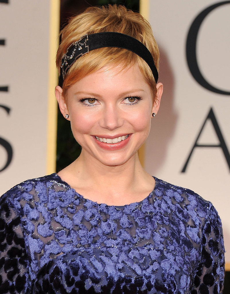 Michelle Williams dressed up her blonde pixie with a dazzling headband.