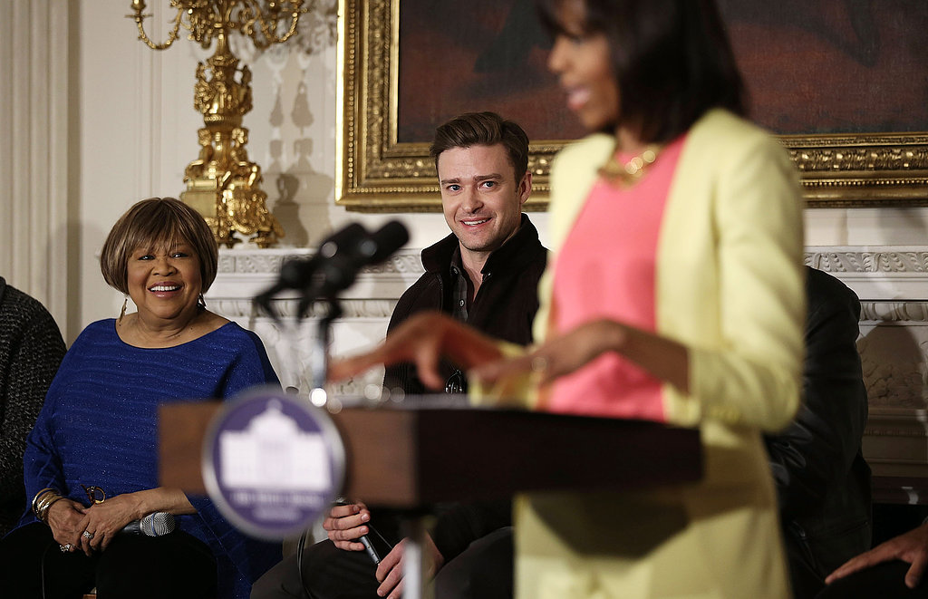 Justin Timberlake watched as Michelle Obama spoke to students.