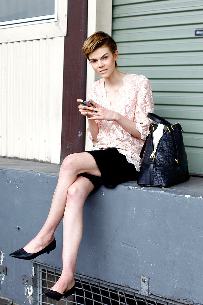 A blush pink lace top added a whimsical touch to black basics.