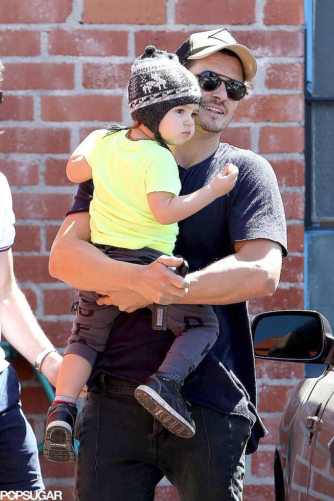 Orlando Bloom held his son, Flynn, in LA.