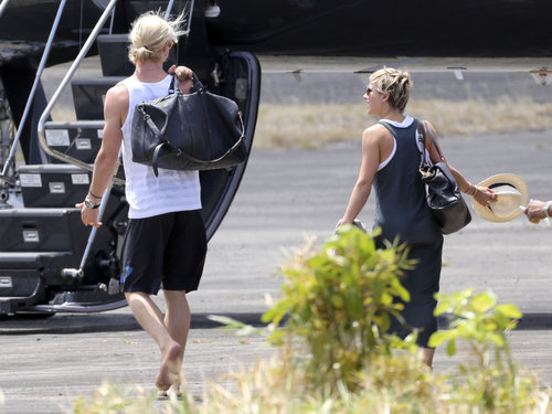 Chris Hemsworth and wife Elsa Pataky prepared to leave St. Lucia after attending Matt and Luciana Damon's wedding vow renewal ceremony in April 2013.