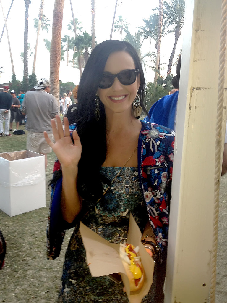 Katy Perry waved in an on-trend mixed-print ensemble.