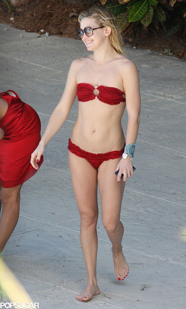 She made her way to Miami in March 2008, when she spent her pool time in a red Indah bikini.