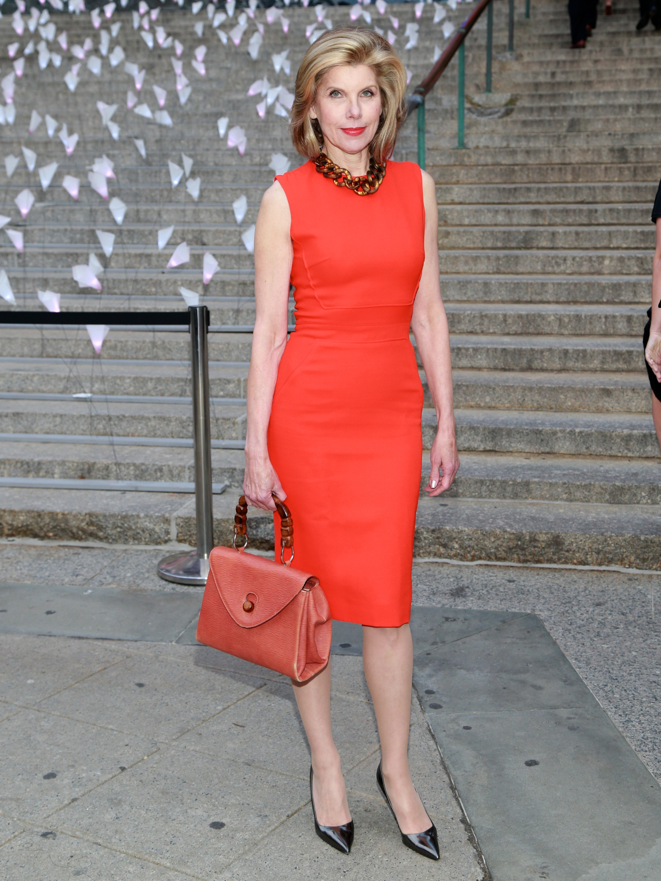 Christine Baranski wore a red dress and held a matching ...