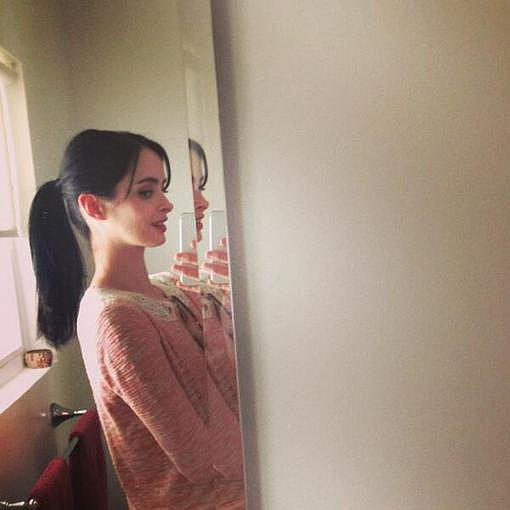 "Krysten Ritter showed off her ""super long ponytail"" in the mirror.  Source: Twitter user Krystenritter"