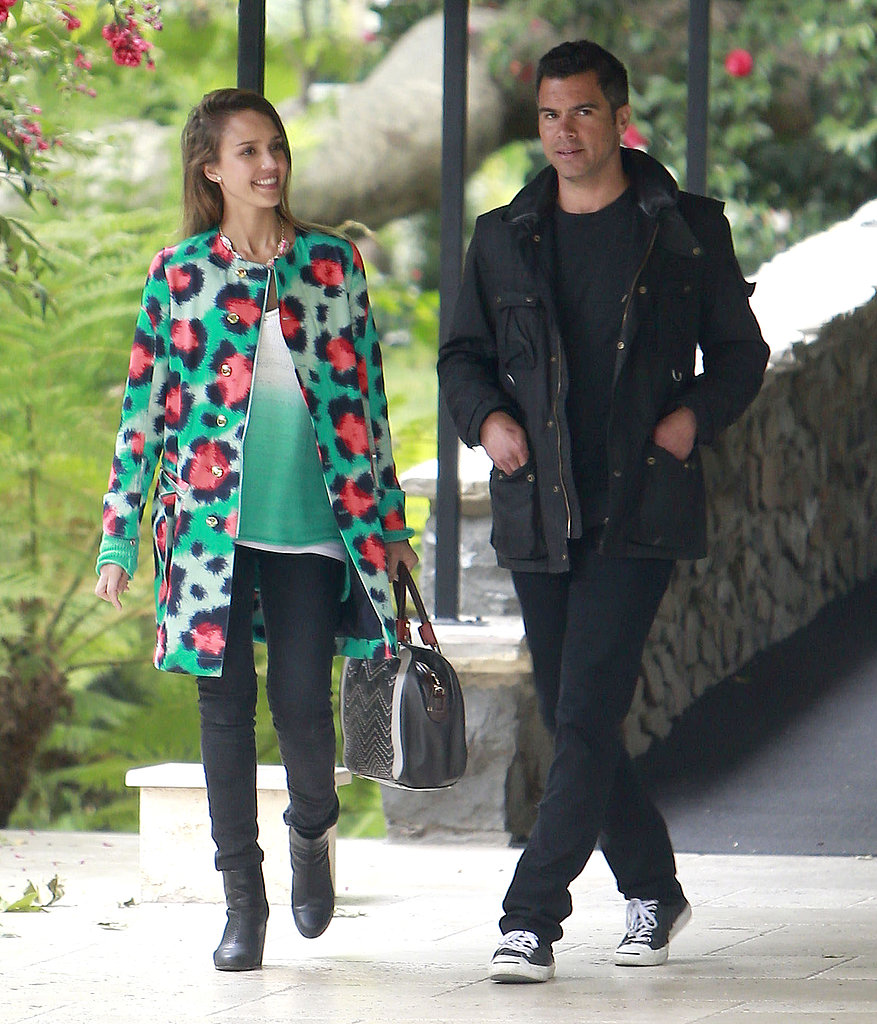 pJessica Alba brightened her washed black denim with a high-wattage Kenzo coat while attending Jessica Simpson's baby shower in Beverly Hills. Husband Cash looked just as cool in his monochrome look.