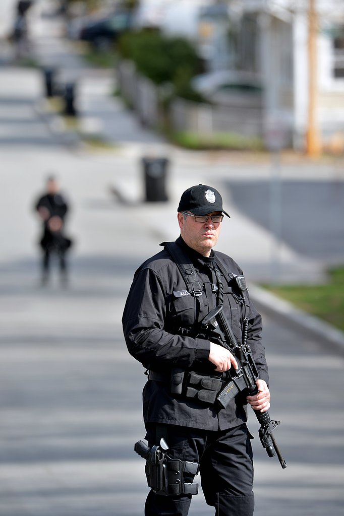 A member of the SWAT team stood guard in the Boston suburb of Watertown.