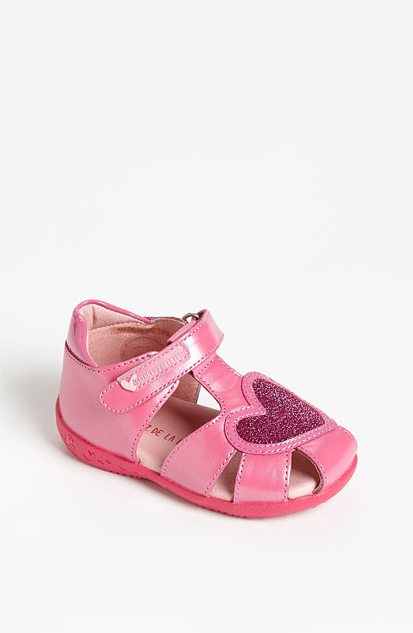 It's never too early for her first pair of designer kicks. Show your little girl the love with Agatha Ruiz de la Prada's glitzy pink fisherman sandals ($79).