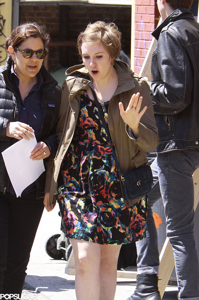 Lena Dunham walked to the set with a crew member.