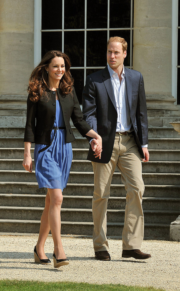 Newlyweds Kate Middleton and Prince William stepped out on the grounds of Buckingham Palace the day after their April 2011 wedding in London.