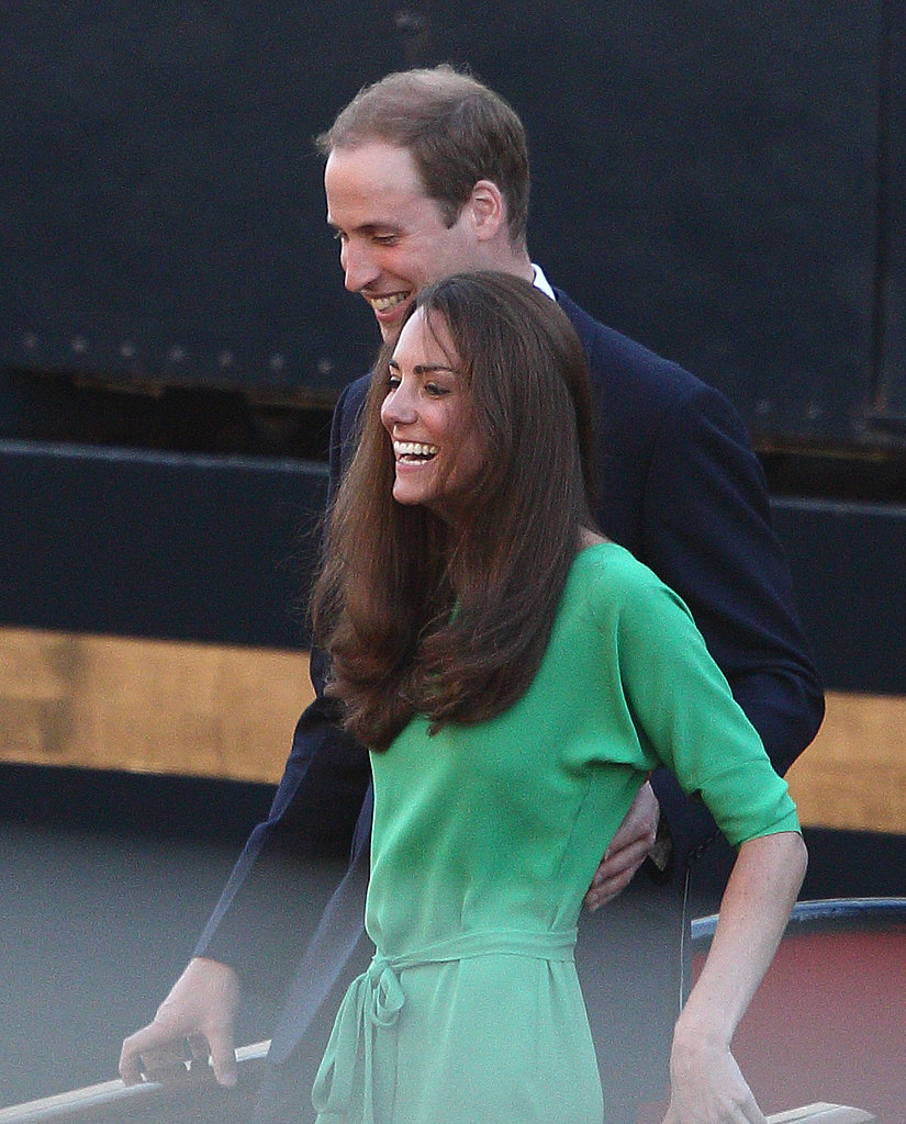 Kate and William let out a laugh at the July 2011 prewedding festivities of Zara Phillips and Mike Tindall in Scotland.