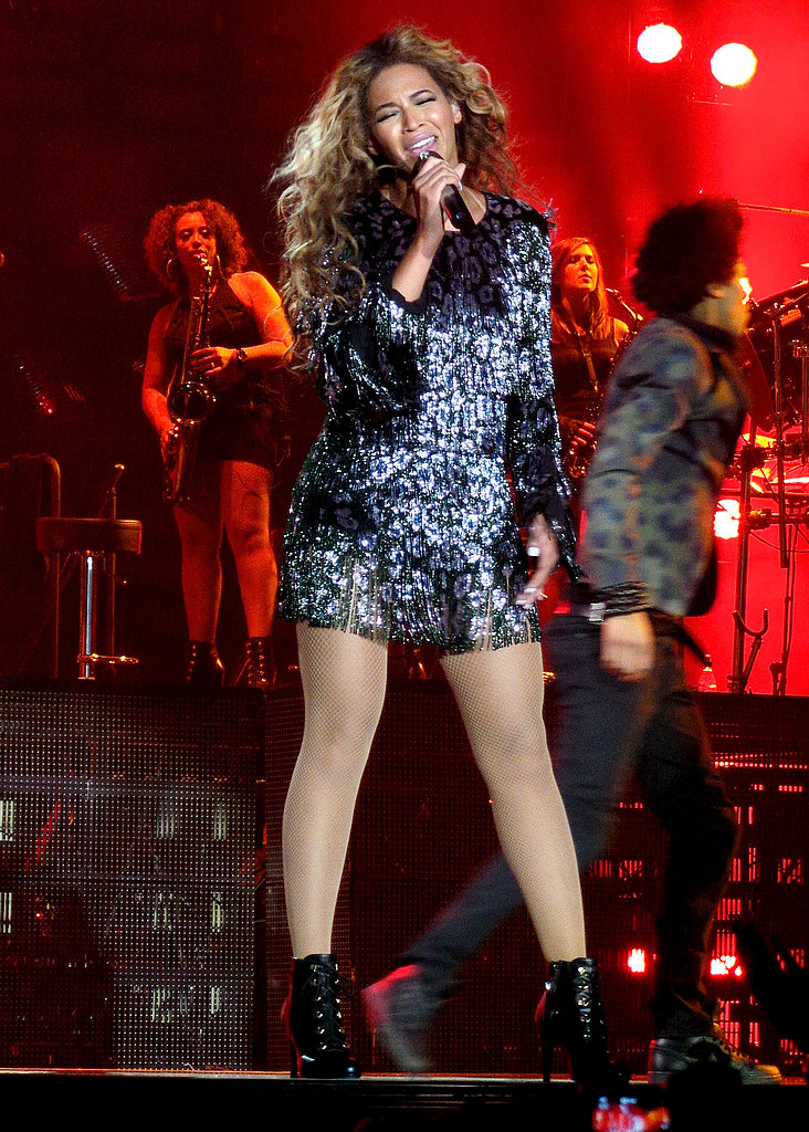 The singer belted out a tune wearing a sequined animal-print minidress with lace-up boots.