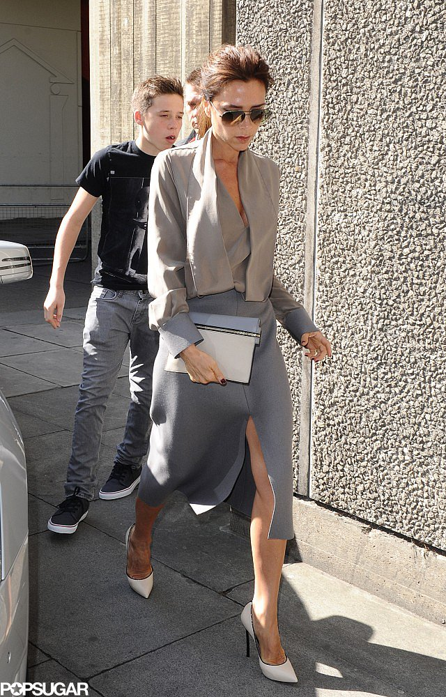Victoria Beckham was sophisticated with a hint of sexy in an ensemble from her Fall '13 collection, which she topped with white piped Casadei pumps in London.