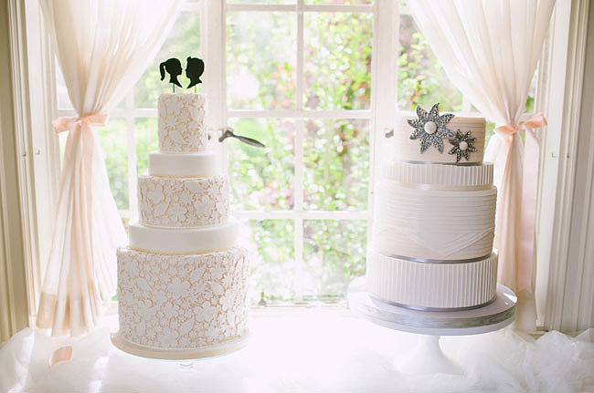 This classic tiered cake on the left looks like it was hand-embroidered with a floral and leaf pattern, and we love that the topper adds a fun, modern touch. Photo by Jodi Miller Photography via Green Wedding Shoes