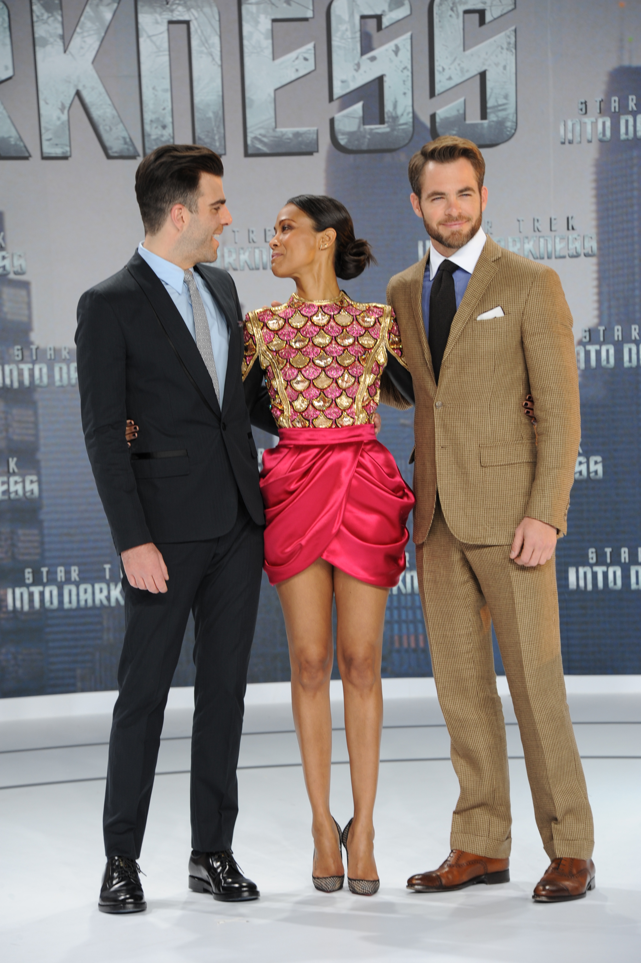 Zachary Quinto and Zoe Saldana shared a moment while posing with Chris Pine at the Star Trek Into the Darkness German premiere.