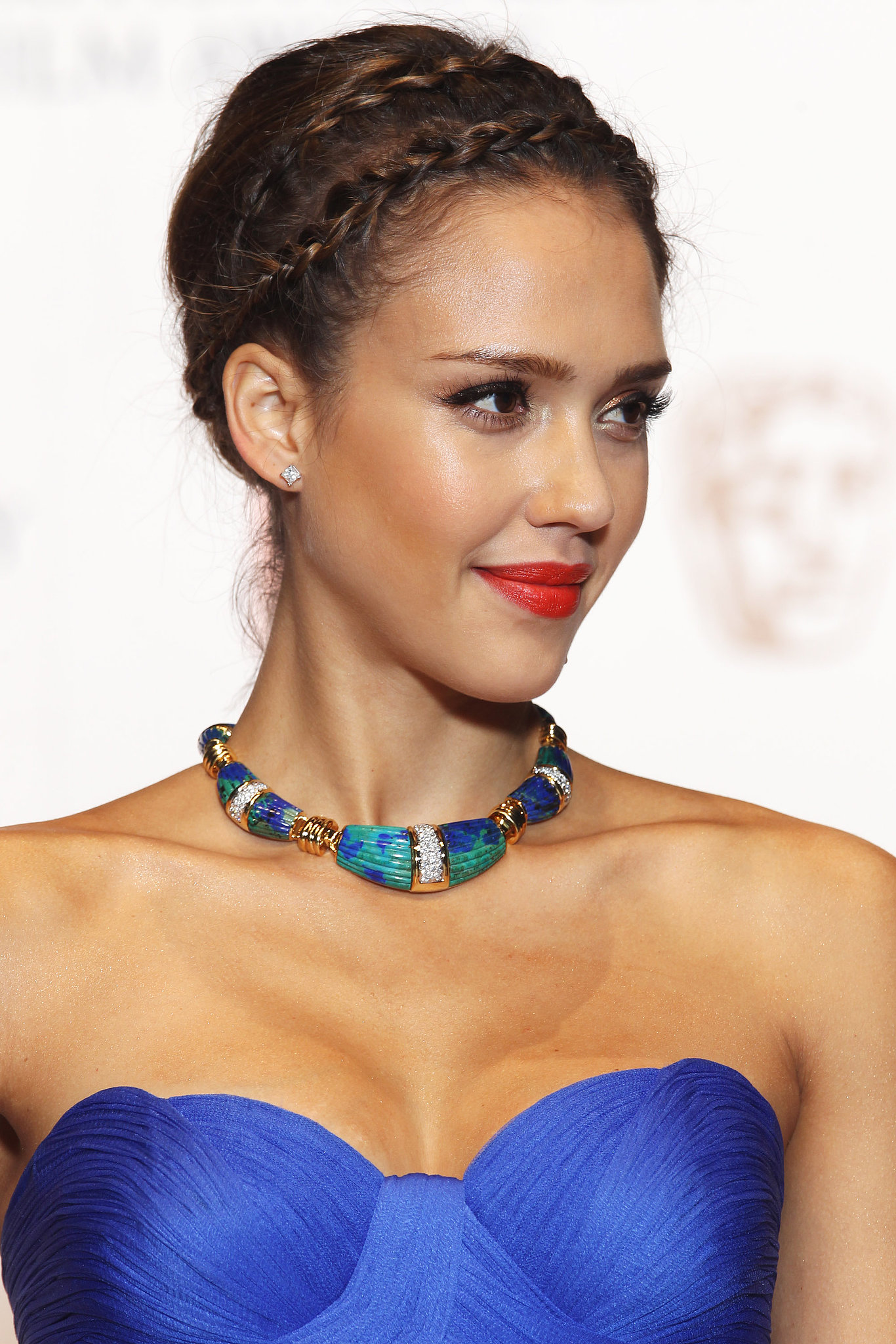 Jessica wore a playful braided style at the 2011 Orange British Academy Film Awards. Her makeup featured orange lipstick to complement her bright blue dress.