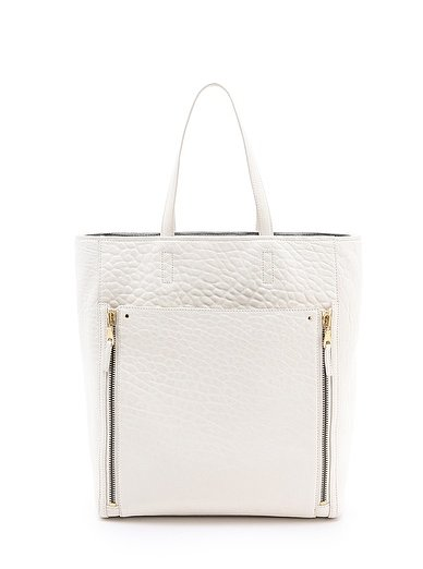 Because we can't always wear the Spring dresses we want to work, I'll rely on this fresh, white Club Monaco Brooke tote ($298) to give my office look a lift, even if I'm just wearing my go-to skinny jeans. — Hannah Weil