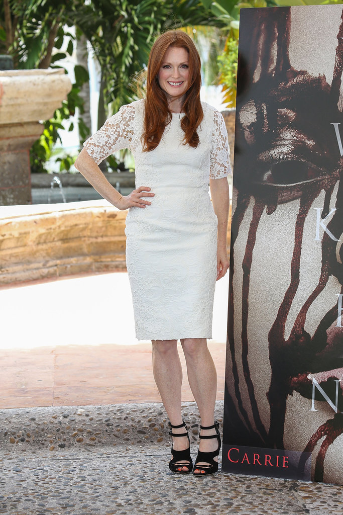 Julianne Moore created a trendy black-and-white pairing in a white lace Dolce & Gabbana dress and black strappy Tabitha Simmons sandals at the Carrie photocall in Cancun, Mexico.