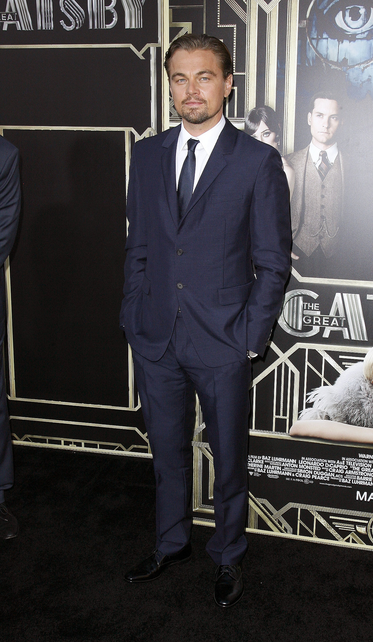 The Great Gatsby star Leonardo DiCaprio looked dapper in a navy blue Prada look.