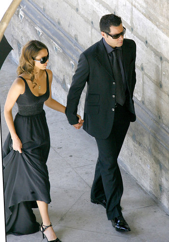 Jessica Alba and Cash Warren held hands before heading into Eva Longoria and Tony Parker's Parisian wedding ceremony in July 2007.
